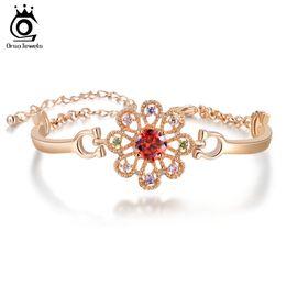 Wholesale Arrow Designs - ORSA Latest Lucky Flower Design Luxury Heart and Arrow Cut Red Zircon Bracelet on Platinum Plated OMB10