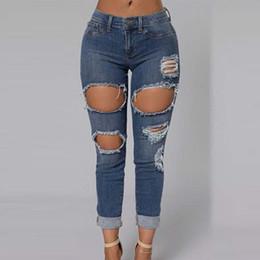 cut ripped jeans - Jean Yu Beauty
