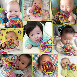 Wholesale Sensory Baby Toys - 2017 new Manhattan Winkel Rattle and Sensory Teether Activity Rings Baby Feeder Silicone Teething Toys Baby Products for Teeth