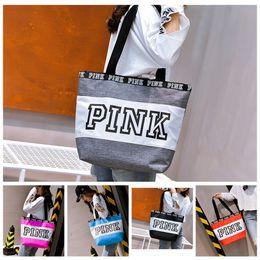 Wholesale Pink Gym Bags - Pink Letter Handbags Shoulder Bags Women Large Capacity Handbags Travel Duffle Striped Waterproof Beach Shoulder Bag 50pcs OOA2766