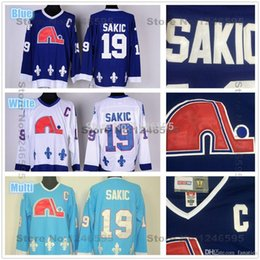 2016 Quebec Nordiques Jerseys # 19 Joe Sakic Jersey Nordiques Home Blue White Authentic Jersey Joe Sakic Hockey Jersey con parche C desde fabricantes