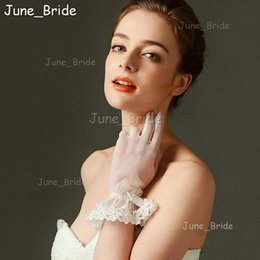 Wholesale Romantic Collection - June Bride Lace Trim Wrist Bridal Gloves Romantic Style Evening Party Gloves Full Finger with Bow High Quality New Collection