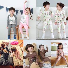 Wholesale Boys Christmas Pajamas 12 - Cartoon Children Pajamas Different Design Big Boys Girls Home Clothing Long Sleeve and Trouser Set Kids Boutique Clothing