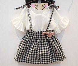 Nuevo 2016 moda niños coreanos del verano del vestido de las muchachas del bebé Flare de manga corta a cuadros dulce elegante princesa vestidos de fiesta de una sola pieza vestidos desde fabricantes