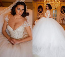 Wholesale Designer Beaded Wedding Gowns - 2017 Luxury Lace Arabic Ball Gown Wedding Dresses Illusion V Neck Bodice Pearls Beaded Cap Sleeve Dubai Bridal Gowns Princess Puffy Designer