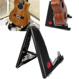 Instrumentos de rack on-line-Universal Suporte de Chão Portátil Suporte Dobrável Acústico Baixo Instrumentos Musicais Quadro Rack de Plástico Ukulele Guitarra Acessórios