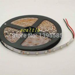 5m 300 LED amarillo / ámbar 3528 SMD 12V luz flexible 60 led / m No impermeable 3528 LED tira de cinta Lámpara led desde fabricantes