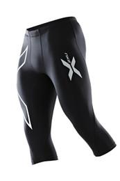 Collant bianco per gli uomini online-Pantaloni sportivi da palestra per uomo di marca all'ingrosso-sportivi Pantaloni a compressione 3/4 Pantaloni della tuta Pantaloni laterali stampati in bianco e nero