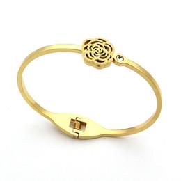 Canada Titane acier Camellia bijoux gros Scrub creux Camellia diamant unique dames bracelet 18K or hommes et femmes bracelets supplier unique diamond bracelets Offre