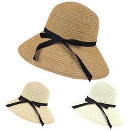 b903fbb2b18dd Al por mayor- 2017 mujeres de ala ancha playa de verano sombrero del sol de  paja disquete elegante bohemia cap papel sombrero de paja