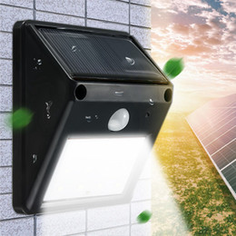 Wholesale Led Solar Powered Street Lights - 12 LED Waterproof IP65 Solar Powered Wireless PIR Motion Sensor Light Outdoor Garden Landscape Yard Lawn Security Wall Lamp