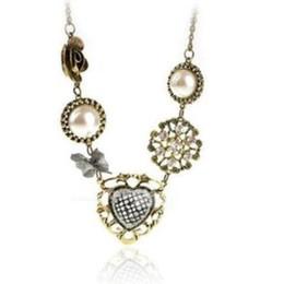 Nova jóia retro luxo doce pêssego arco colar de pérolas atacado camisola cadeia de Fornecedores de coruja pingentes de ouro branco