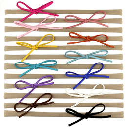 Wholesale Color Sticks For Hair - 2016 New Faux Leather Bow Baby Girl Elastic Nylon Headband Chic European Hair Accessories For Kids Headwrap Headwear 30pcs