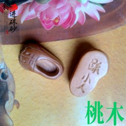 Wholesale Tiger Wood Carvings - [produced] wholesale bell into pure natural peach wood carving pendant accessories DIY evil villain hitting tiger shoes