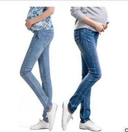ebbc5c94bb6d4 Elastic Waist Hole Stretch Denim Maternity Belly Jeans Autumn Spring Pants  Clothes for Pregnant Women Pregnancy Pencil Trousers
