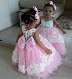Wholesale green day baby - baby pink flower girls dresses with sheer neck lace applique A line girls pageant dress with bow sash buttons back first communion dress