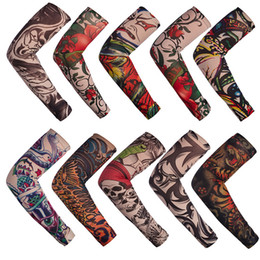 12Pcs / Lot Mix Elastic Fake Tatuaggio temporaneo Sleeve 3D Art Designs Body Arm Gamba calze Tatoo Cool Uomo Donna da