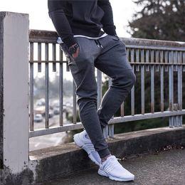 Wholesale Muscles Men Pants - Fashion men dress trousers 2017 new muscle brothers sports pants for men 3 colors m-xl jogging trousers finess training pants