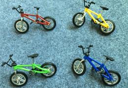 Argentina Nuevas motos de aleación Aleatorios nuevos juguetes de escritorio Flick Trix dedo bicicleta envío gratis Suministro