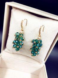 Canada L'Europe et les États-Unis mode coréenne exquise perlée à la main importés boucles d'oreilles en cristal de haute qualité Offre