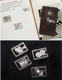 designs de marcadores Desconto Marcador De Aço Inoxidável Bookmark Como Um Filme Filme Reel Film Slate Filme Lighthing Casamento De Metal Parágrafo Criativo Multi Designs