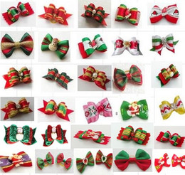 Wholesale Bow Supplies - 100pcs lot Big Sale Christmas Pet Dog Hair Bows bowknot hairpin head flower Pet Supplies Grooming Holiday Dog Accessories Y11