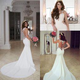 Wholesale Ivory Silk Wedding Dress - 2017 Gergous Sleeveless Mermaid Wedding Dresses Woman Sheer Jewel Neck Cutaway Sides Lace Applique Bridal Gowns With Long Train