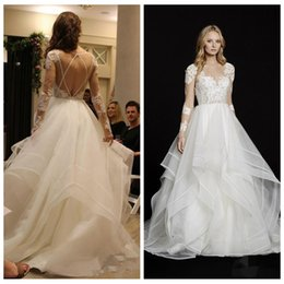 Wholesale Sexy Design Wedding Gown - 2017 Criss Cross Back Lace Appliques Long Sleeves A-Line Wedding Dresses Ruffles Chapel Train Bridal Gowns Custom Online New Design