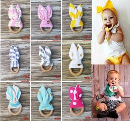 Wholesale Baby Wood - INS Baby Chevron Zigzag Teethers 28Colors Natural Wood Circle With Rabbit Ear Fabric Newborn Teeth Practice Toys Training Handmade Ring