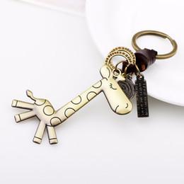 Wholesale Giraffe Rings - Vintage Weaving Giraffe Pendant Keychain Leather Metal Keyring Bronze Metal Giraffe Keyrings Punk Bag Car Key Holder Ring