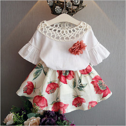 Wholesale Child Skirt Cute - Free shipping 2016 cute white butterfly sleeve pullover tops & printed flower skirt set children clothes summer sets baby girl child 2pcs