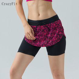 2019 falda de correr xl Al por mayor-Mujeres de deportes profesionales de la aptitud que se ejecutan yoga pantalones cortos de jogging de las mujeres pantalones cortos de tenis falda anti exposición shorts de falda de tenis rebajas falda de correr xl