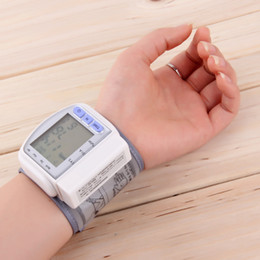 Wholesale Monitoring Heart Beat Meter - Wholesale-High Quality Digital LCD Automatic Wrist Blood Pressure Monitor Heart Beat Rate Pulse Meter Measure