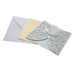 Wholesale wedding invitations blank inside - Wholesale- 20Pieces Bowknot Wedding Invitation Card Laser cut White Hollow Flowers Blank Inside with Envelope