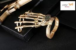 Canada Matt Gold Chain Halloween Main Crâne Squelette Élastique Bracelet Bracelet Gothique Crâne Partie Arme Mosaïque Engrenage Bijoux Pour Femmes Offre