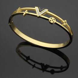 Wholesale channel flower - Titanium steel bracelets jewelry wholesale V-shaped diamond hollow four-leaf flower bracelets 18K gold couple trade brand bracelets