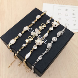 Wholesale White Indian Jewellery Set - New Charm Bracelet Quality Cat Eye Gem Stone Pearl Jewellery Swarovski Rhinestone Crystal Korean Fashion Bracelet color retaining free DHL