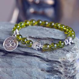 Wholesale Om Beads - Olivine,Peridot Bracelet,Lotus Buddha Bracelet,Heart Chakra healing, Lucky Elephant Bracelet,OM bracelet, meditation yoga mala beads prayer