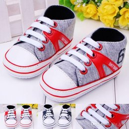 Wholesale eyelet lace - Hot Wholesale Cute Lovely Lace-up Eyelets Canvas Sport Shoes Ffirst Walker Baby Boy Shoes Free Shipping