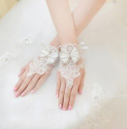 Wholesale Party Lace Gloves - 2016 White lace gloves Women Wedding Gloves Bow Beads Fingerless Gloves Accessories Wrist Length for Wedding Party