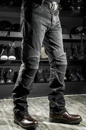 Motos de motos online-Envío gratis Komine motocicleta jeans pantalones de motocicleta weerstand dunne denim broek rally moto broek blauw mannen modo Jeans protección jeans