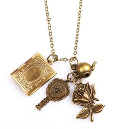 Wholesale Gold Book Charm - Retro Antique Bronze Color Beauty And The Beast Pendant Necklace With 4pcs Rose Flower Key Teapot Magic Book Charm Fine Jewelry