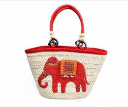 Wholesale Elephant Crochet - Newest handmade straw woven red elephant handbag Shoulder tote bag Summer beach beaded straw bag Factory direct sales