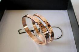 Wholesale Couple Bracelets Korea - South Korea version 18K rose gold bracelet and a titanium bracelet jewelry to couple bracelet gift money