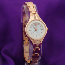Wholesale Gold Plated Ladies Watches - Free shipping!Gold plating,metal alloy band,alloy round case with crystal deco,quartz movement,jw fashion woman lady bracelet quartz watches