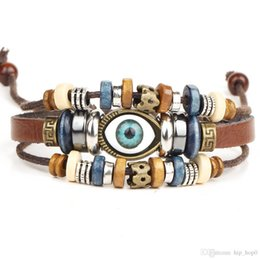 Canada Bijoux en oeil fait main unisexe filles femmes bracelets en cuir bracelet bleu mauvais oeil perle bracelets en cuir pour hommes bijoux de mode supplier evil eye wristbands Offre