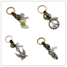 Wholesale Jewelry Rings Peace - Mens Genuine Leather Weave Key Rings vintage Alloy Maple Leaf Map Ghost Hand Peace Symbol Eagle Pendant Key Chain For Men Jewelry Gifts