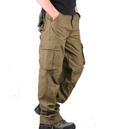 Al por mayor-Nuevo estilo de la manera de los hombres del desgaste del desgaste grande de la primavera del color de los pantalones largos de cuatro colores que trabajan los pantalones de la cremallera bolsillos de la mosca acogedores desde fabricantes