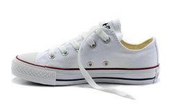 Zapatillas deportivas más vendidas online-2016 Venta caliente 35-45 Nuevo Unisex Low-Top Adultos Lona de los hombres de la Mujer zapatos para correr 13 colores con cordones zapatos casuales zapatillas
