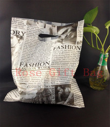 Wholesale Wholesale Newspapers Bags - 50pcs lot Black Newspaper Design Plastic Gift Bag 25x35cm Clothes Jewelry Packaging Bag Big Plastic Shopping Bags With Handle